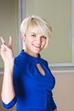 Girl with victory gesture Royalty Free Stock Image