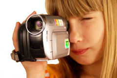Girl and video camera Royalty Free Stock Photos