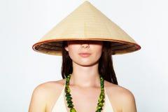 Girl in Vietnamese hat Stock Photos