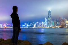 Girl viewing Hong Kong skyline Stock Photos