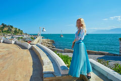 Girl at viewpoint near old harbor with yachts. Stock Photos
