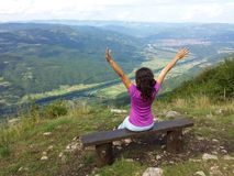 Girl at the viewpoint spreading her hands Stock Images