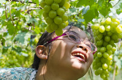 Girl in vineyards. Girl smiling was happy in vineyards Stock Photo