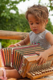 Girl with a vintage accordion Stock Photo