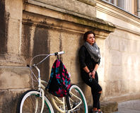 Girl with vintage bicycle on background of wall ancient building Royalty Free Stock Images