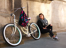 Girl with vintage bicycle on background of wall ancient building Royalty Free Stock Photography