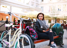 Girl with vintage bicycle sits in the street old town Royalty Free Stock Photography