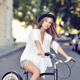 Girl on a vintage bike Stock Photo