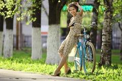 Girl  with vintage bike Stock Photos