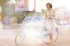 Girl  with vintage bike Stock Photo