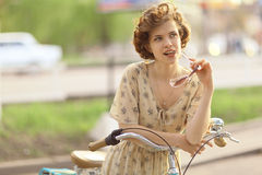Girl  with vintage bike Stock Images