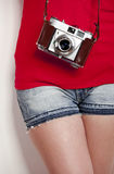 Girl with a vintage camera Stock Images
