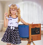 Girl with vintage camera Royalty Free Stock Photos
