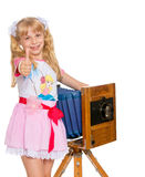 Girl with vintage camera Royalty Free Stock Photography