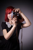 Girl with vintage camera Stock Photo