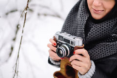 Girl with a vintage camera Stock Image