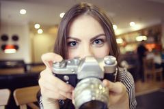 Girl with a vintage camera stock photography