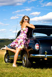 Girl and a vintage car Stock Photos