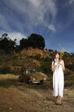 Girl and vintage car. With dark sky as background royalty free stock image