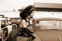 Girl at vintage car Stock Photos