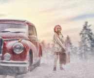 Girl and vintage car. Toward adventure! Girl relaxing and enjoying road trip. Happy girl and vintage car on snowy winter nature background. Christmas holidays stock images