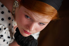 Girl in vintage clothes. High angle portrait of fashionable girl in vintage or retro clothes with hat and red hair Royalty Free Stock Images