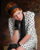 Girl in vintage clothes. Half body portrait of attractive red headed girl in vintage clothes with gloves and scarf Stock Image