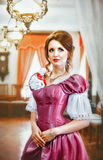 Girl in a vintage dress in the room Royalty Free Stock Photo