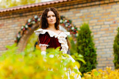 Girl in a vintage dress Stock Images