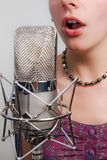 Girl with vintage microphone Stock Photography