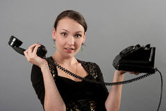 Girl with a vintage phone Royalty Free Stock Images