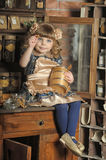 Girl in a vintage room Royalty Free Stock Images