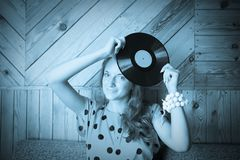 Girl at vintage room with vinyl plate Royalty Free Stock Images