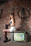 Girl on vintage TV receiver Stock Photos