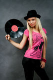 Girl with a vinyl in a black hat Stock Images