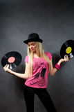 Girl with a vinyl in a black hat Royalty Free Stock Images