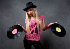 Girl with a vinyl in a black hat Royalty Free Stock Photos
