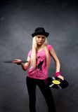 Girl with a vinyl in a black hat Royalty Free Stock Photo