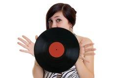 Girl and vinyl disc Stock Photos