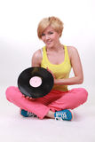 A girl with a vinyl disc in the hands of Royalty Free Stock Image