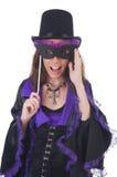 Girl in violet and black dress holding mask Stock Image