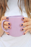 Girl with violet coffee mug Stock Photos