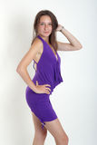 Girl in a violet dress Stock Image