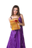 Girl in violet dress, holding gift box Royalty Free Stock Image
