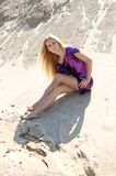 Girl in the violet dress on the sand Royalty Free Stock Images