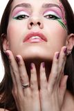 Girl with violet fingernails Royalty Free Stock Images