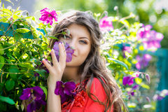 girl in violet flowers Stock Photos