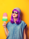 Girl with violet hair and ice-cream Royalty Free Stock Photography