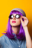 Girl with violet hair in sunglasses Stock Photography