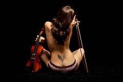 Girl with violin Stock Images